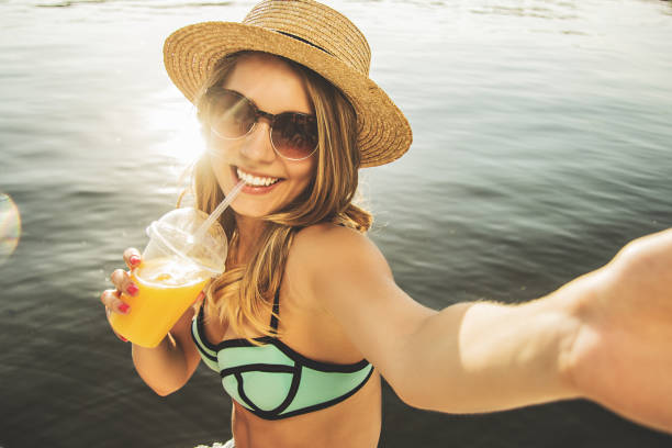 capturing every happy summer moments. - drinking juice stock photos and pictures