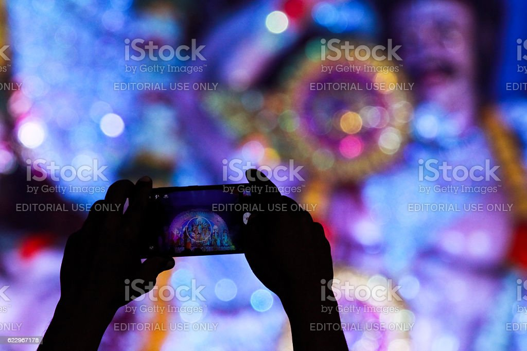 Capturing idol of goddess durga in mobile stock photo