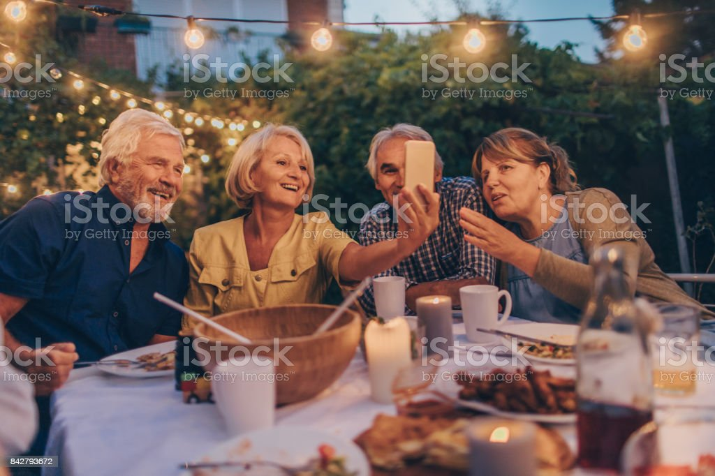 Capturing memories from dinner party stock photo