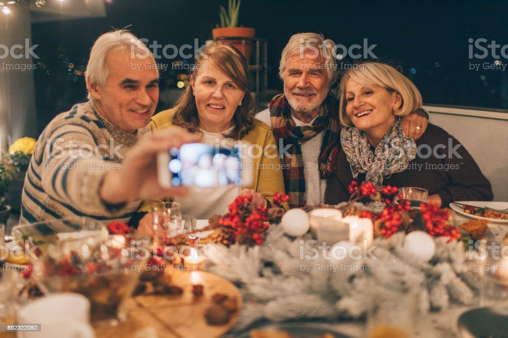 Capturing Thanksgiving memories - Royalty-free 60-69 Years Stock Photo