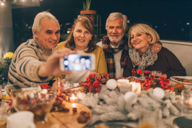 capturing thanksgiving memories - baby boomers stock pictures, royalty-free photos & images