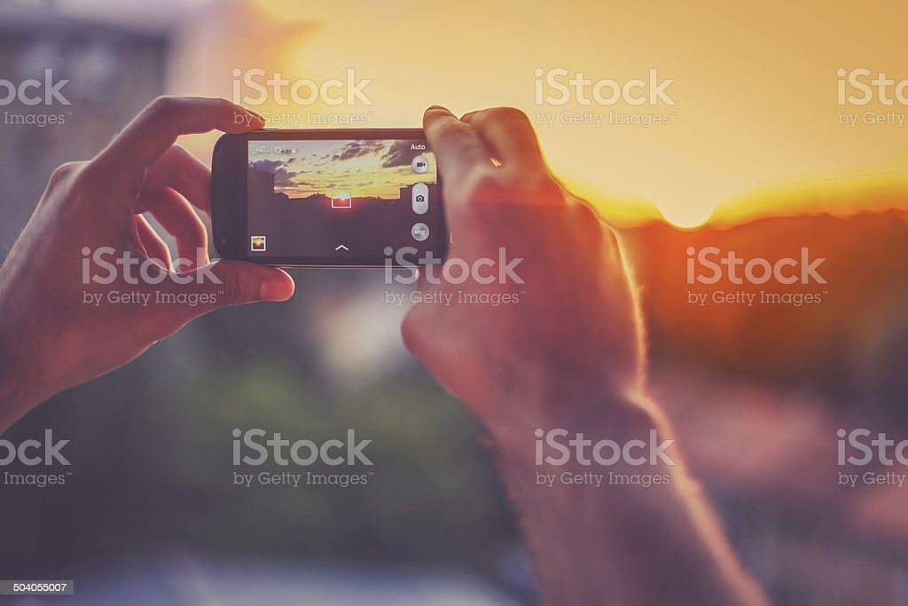 Capturing the moment with a smartphone stock photo