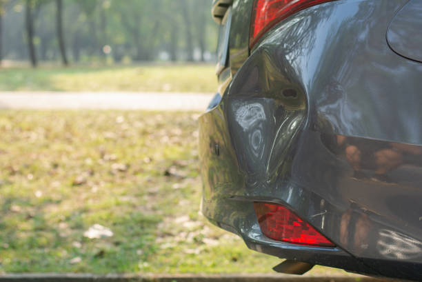 car a broken rear bumper, the car stopped on road which has damage or dent at rear side of car ,damage car accident, copy space. - dent stock pictures, royalty-free photos & images