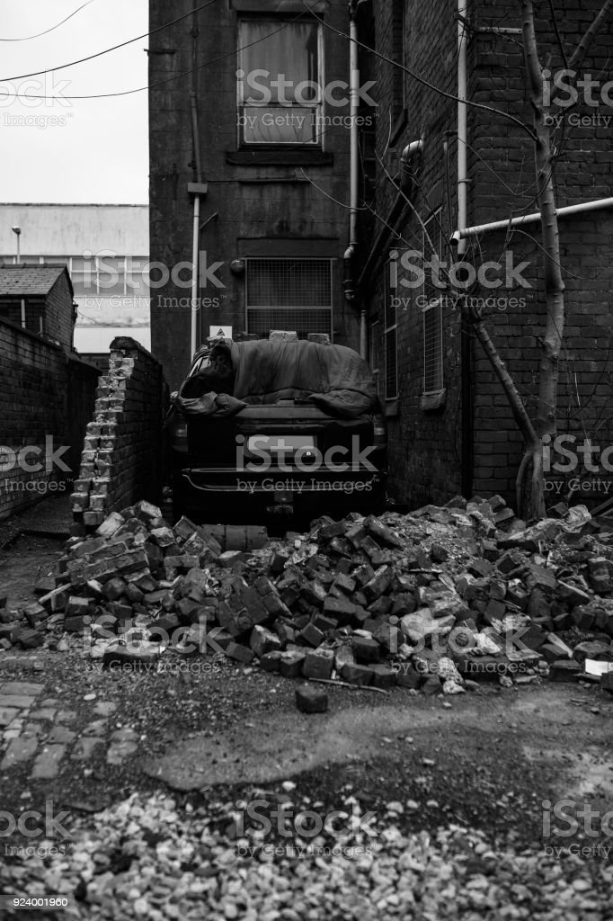car accident against a wall of bricks stock photo