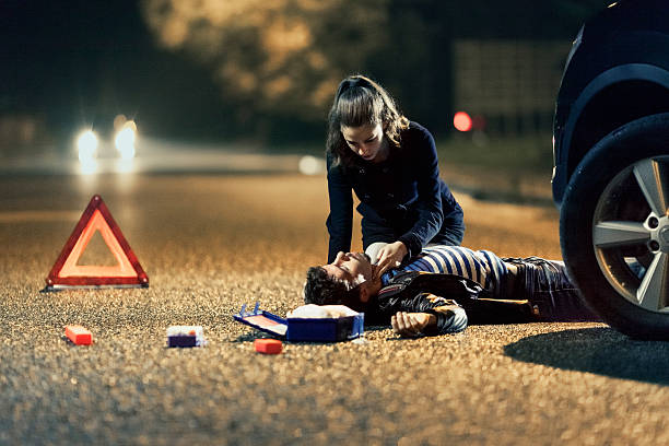car accident - first aid - first aid stock photos and pictures