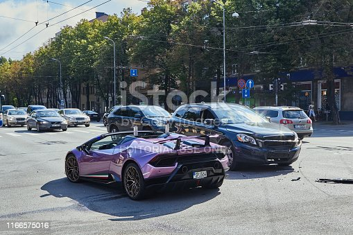Riga, Latvia, June 25, 2019: Car accident on a city road on luxury sports car after collision with a crossover