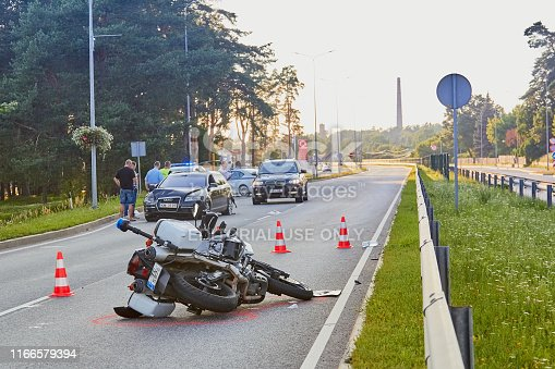 Car accident on a road in 24th of June 2019 in Ogre Latvia, police motorcycle after a collision with a car, transportation background