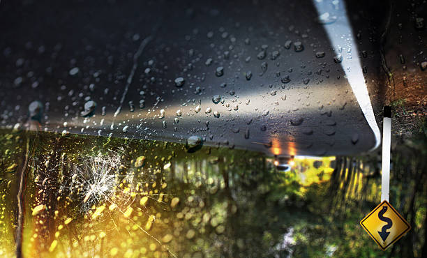 car accident on heavy rainy day. - impaired driving stock photos and pictures