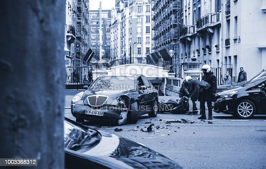 684793794istockphoto Car accident on Paris street between luxury limousine Lancia Thesis and scooter 1003368312