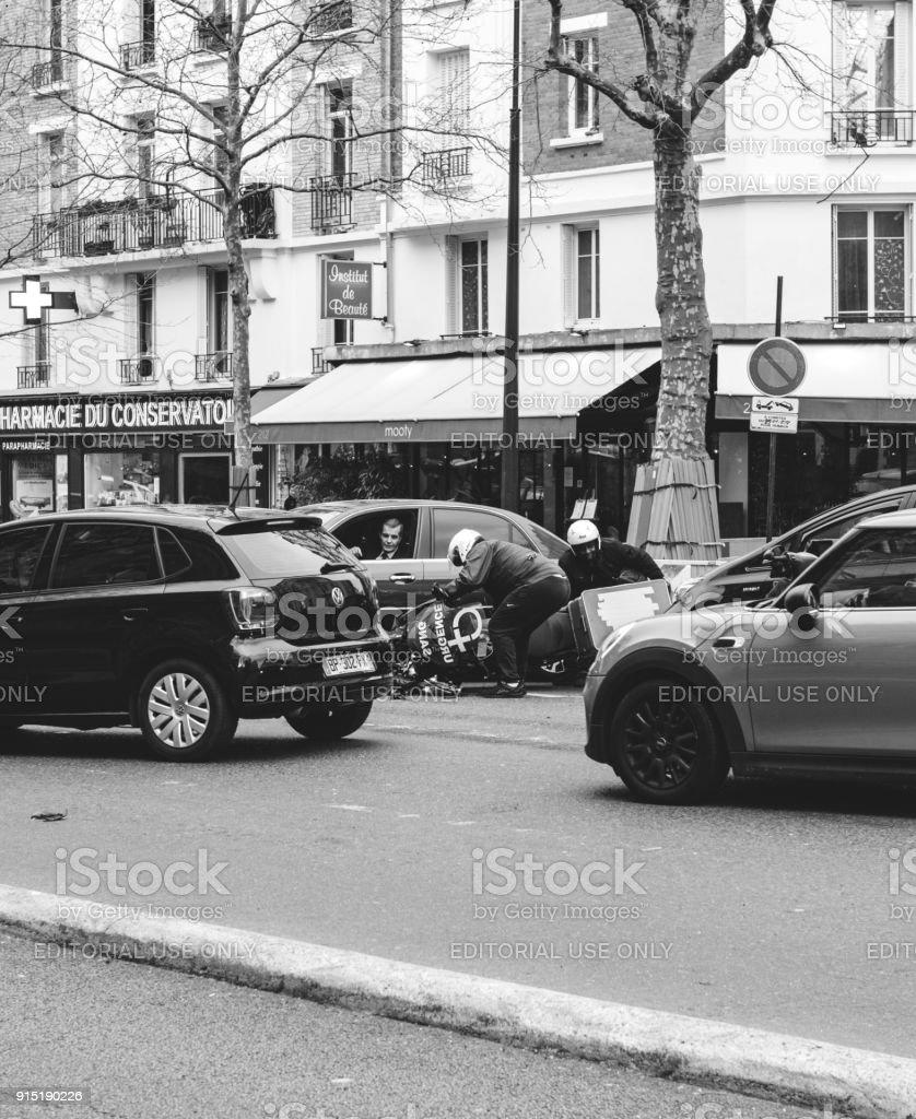 Car accident on Paris street between luxury limousine Lancia Thesis...