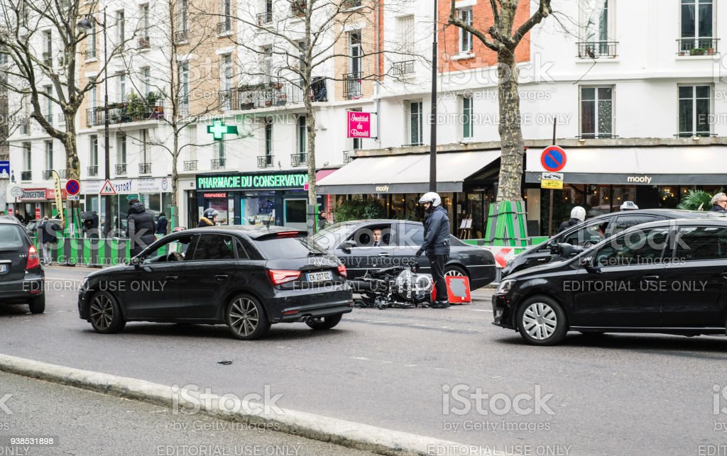 Car Accident On Paris Street Between Luxury Limousine Lancia Thesis