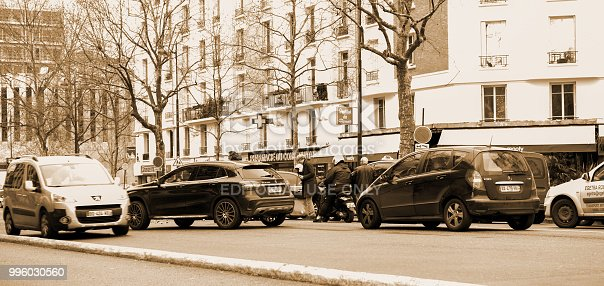 684793794istockphoto Car accident on Paris street between luxury limousine Lancia Thesis 996030560