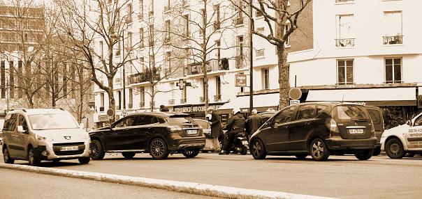 684793794 istock photo Car accident on Paris street between luxury limousine Lancia Thesis 996030560