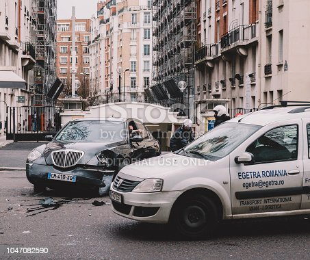 684793794istockphoto Car accident on PAris street help 1047082590