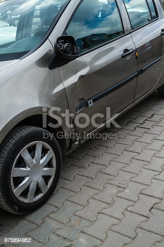 684793794istockphoto Car Accident on Street, Damaged Automobiles After collision 975894952
