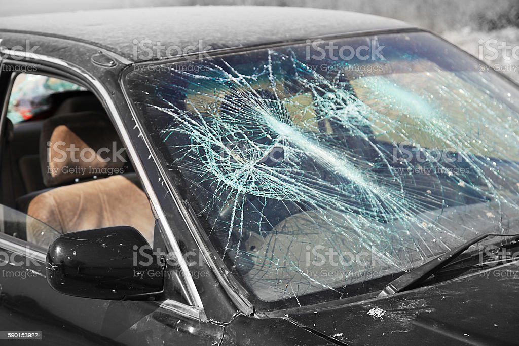 Car accident with shattered front windshield stock photo