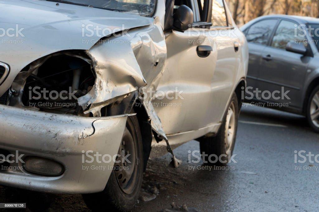Car after crash, crashed blue car, accident close up