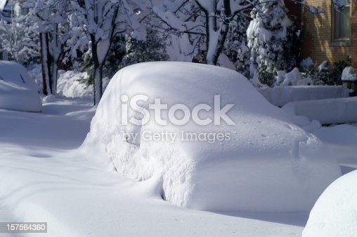 Car on city street after large snowfall.