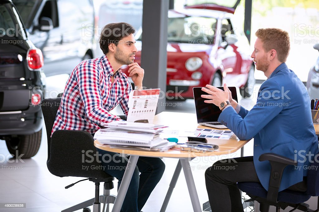 car agent talking with customer stock photo