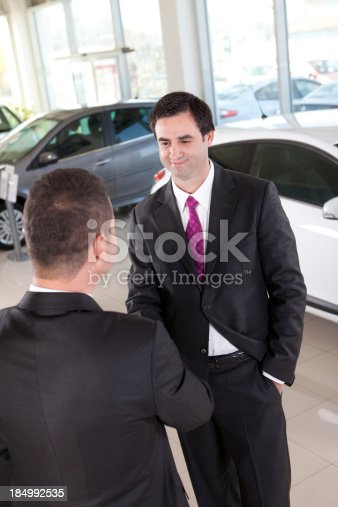 Young businessman is buying a car.
