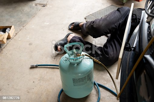 istock Car air conditioner check service, leak detection, fill refrigerant, Manometer being used to gauge 981282776