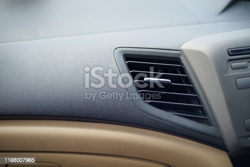 istock Car air conditioner grid panel on console Close up 1168007965