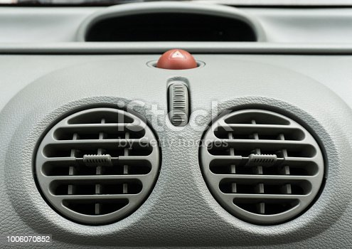 824789150 istock photo Car air conditioner grid panel on console 1006070852