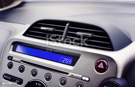 824789150 istock photo Car air conditioner in the front interior passenger. 824789144
