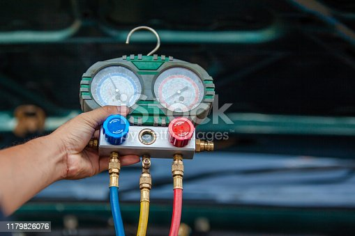 962280084 istock photo car air conditioner system in car garage, Car air conditioner check service, leak detection, fill refrigerant 1179826076