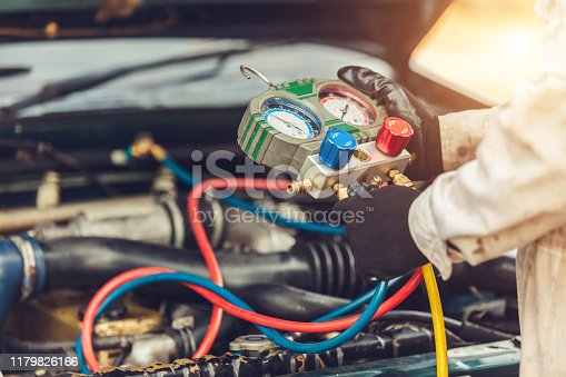 962280084 istock photo car air conditioner system in car garage, Car air conditioner check service, leak detection, fill refrigerant 1179826166