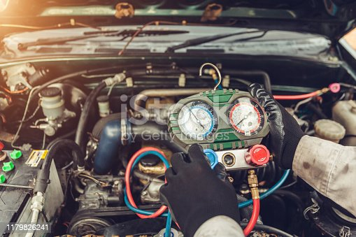 962280084 istock photo car air conditioner system in car garage, Car air conditioner check service, leak detection, fill refrigerant 1179826241