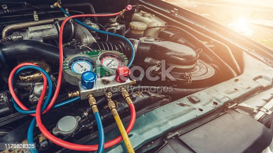 istock car air conditioner system in car garage, Car air conditioner check service, leak detection, fill refrigerant 1179826325