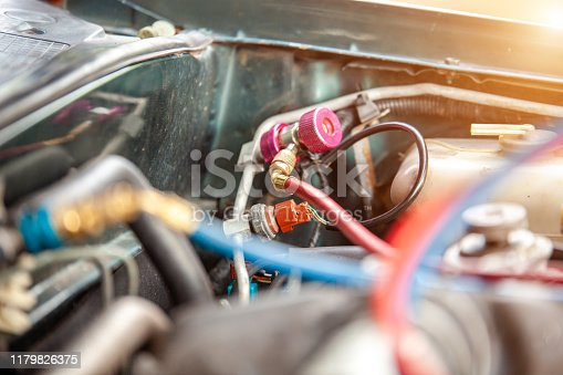 962280084 istock photo car air conditioner system in car garage, Car air conditioner check service, leak detection, fill refrigerant 1179826375