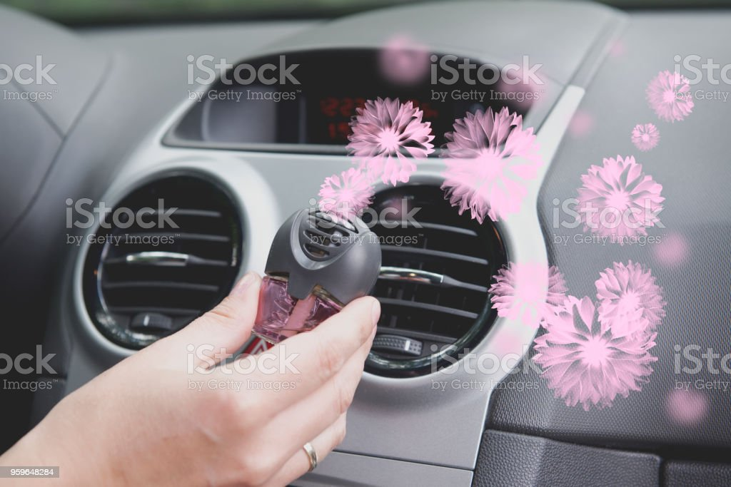 Car air freshener mounted to ventilation panel stock photo