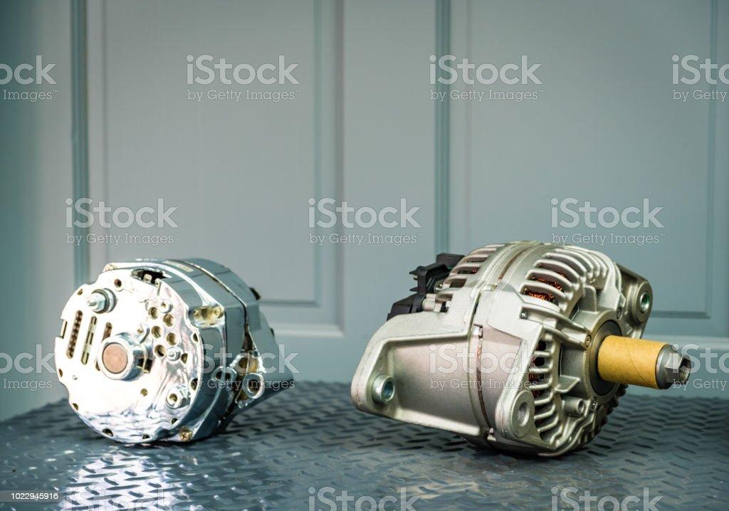 Car alternator on display on metal shelf/auto parts stock photo