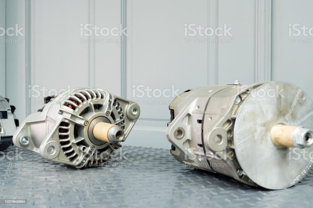 Car alternators on display on metal shelf/auto parts stock photo