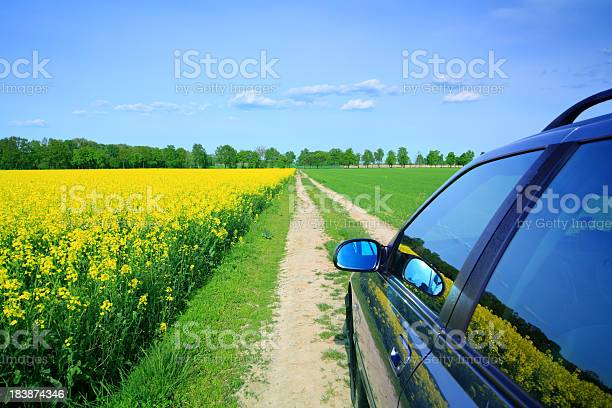 Car Among The Fields Country Landscape Stock Photo - Download Image Now