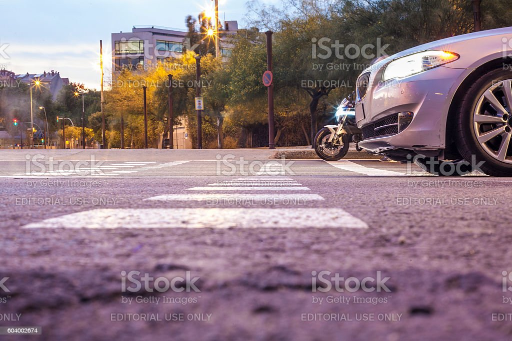 Car and bike waiting with red light on stock photo