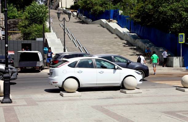 car and concrete balls - ford focus stock photos and pictures