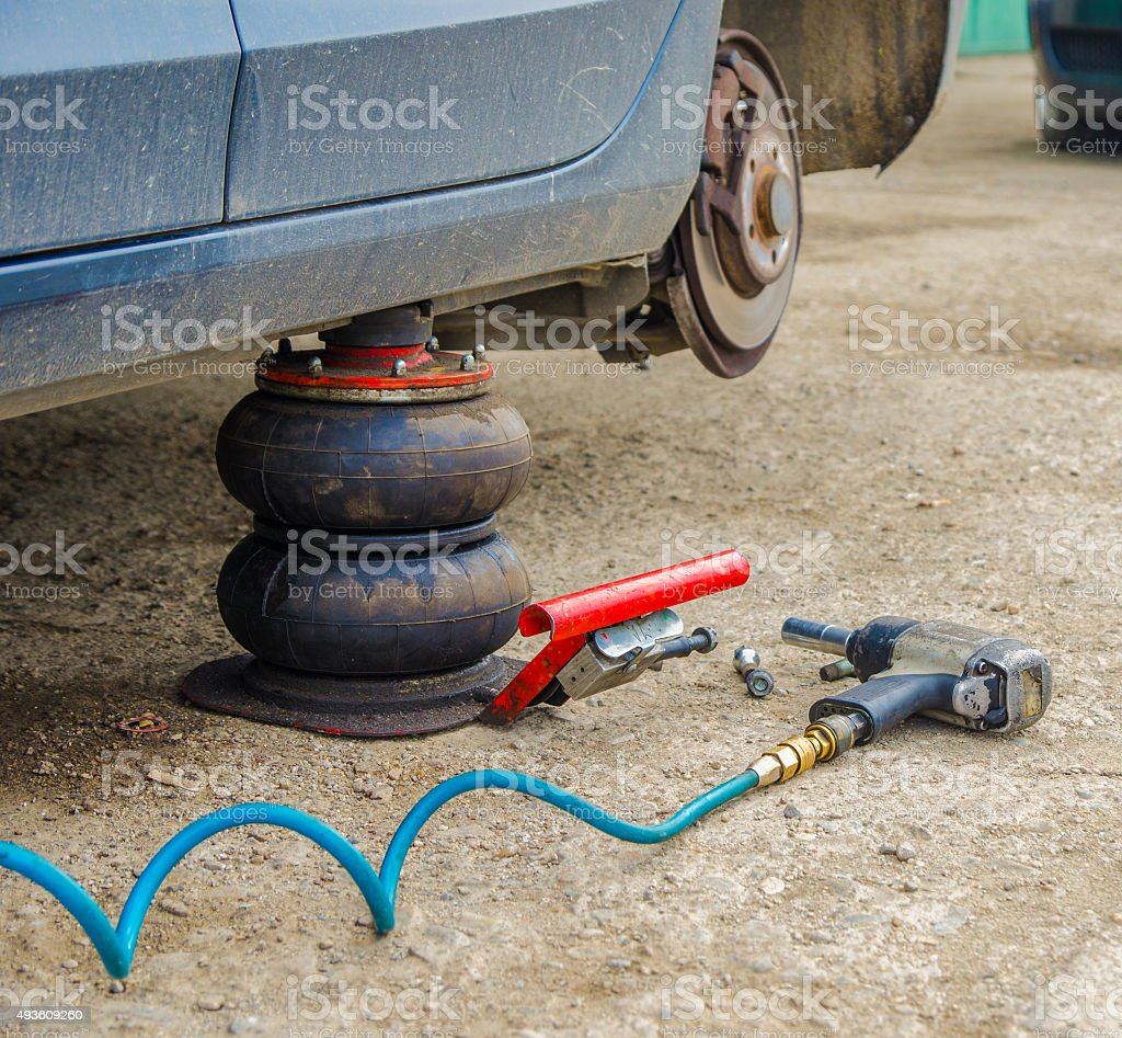 Car and pneumatic tools at a workshop stock photo