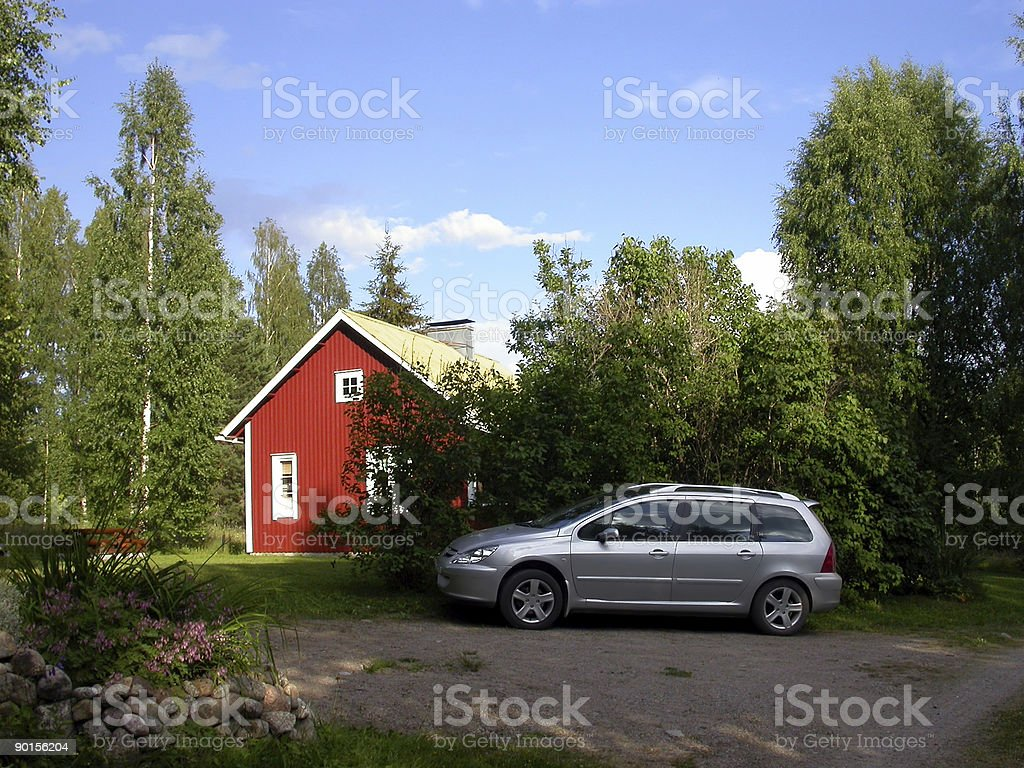 Car and red house stock photo