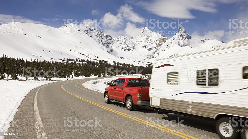 Car and travel trailer in the mountains stock photo