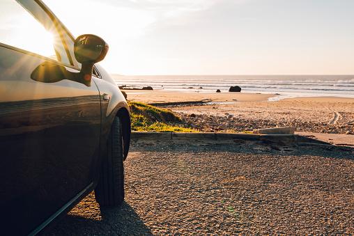 Car at beach at sunset