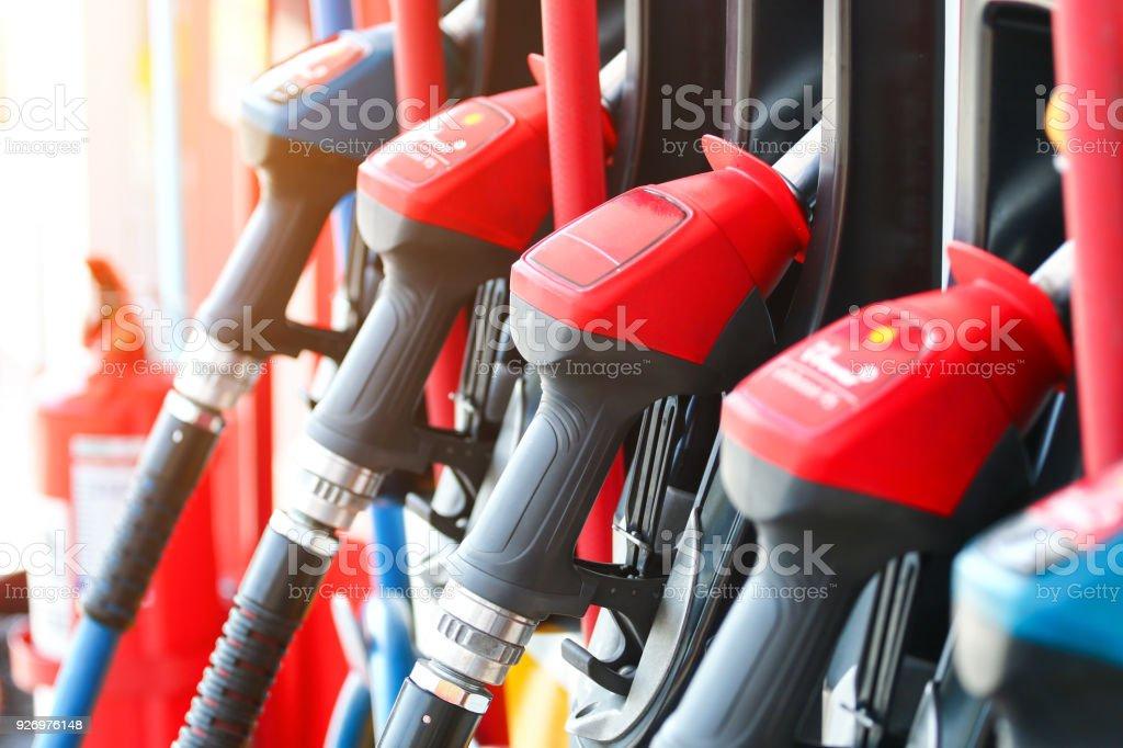 car at gas station .pump gas stock photo