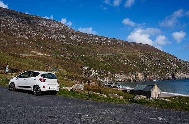 car at Keem Strand Achill Island Mayo Ireland stock photo
