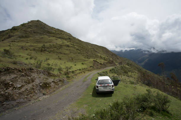 car atop the andes mountains - stranded stock pictures, royalty-free photos & images