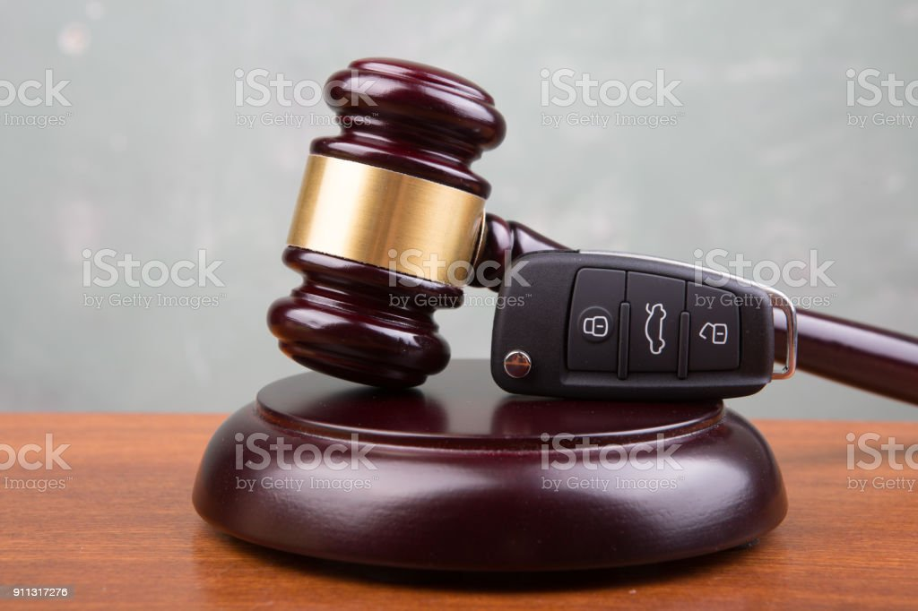 Car auction concept - gavel and car key on the wooden desk stock photo