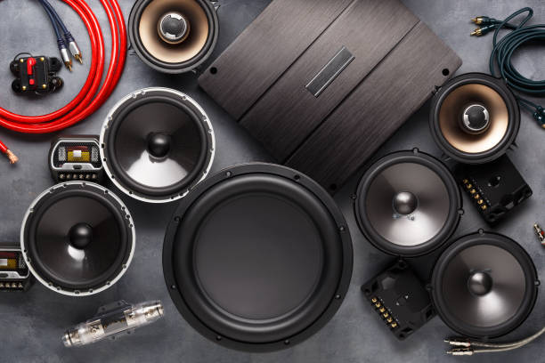 car audio, car speakers, subwoofer and accessories for tuning. Dark background. Top view. stock photo