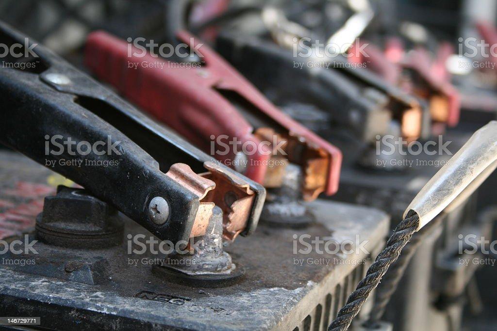 Car batteries charging stock photo