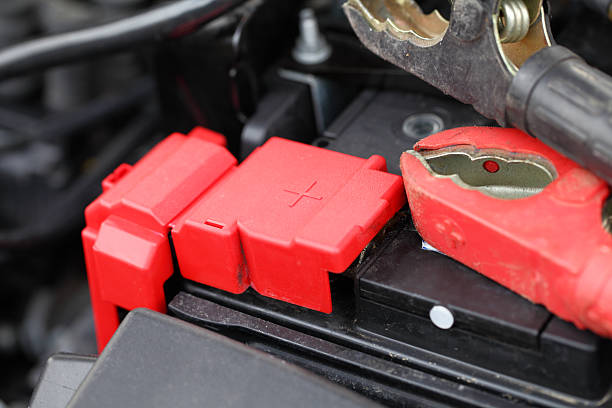 car battery and jump leads stock photo